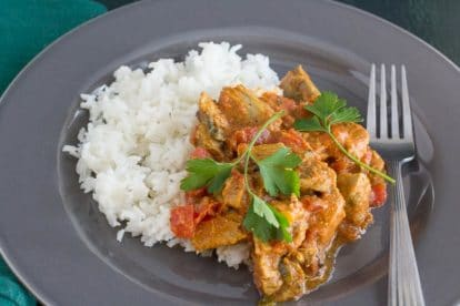 easy lamb curry and basmati rice on a gray plate with fork alongside
