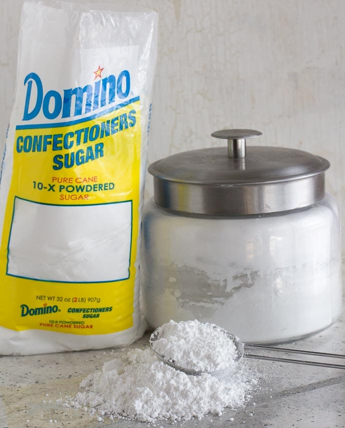 All About Sugar. Confectioners' sugar in a bag and on counter