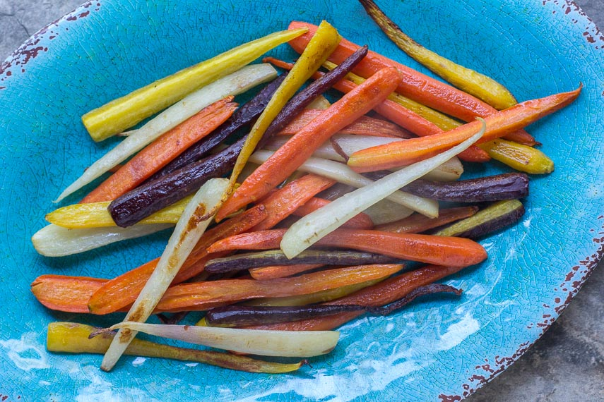 roasted & glazed carrots, rainbow carrots, on an aqua oval platter