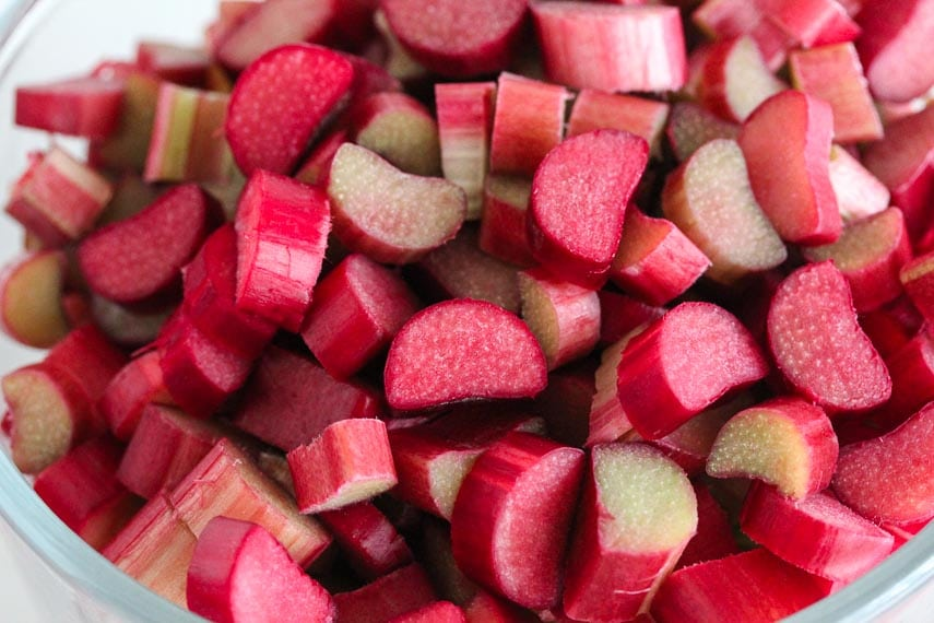 glass bowl of chopped red rhubarb