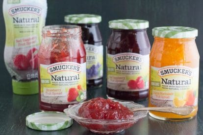 Main image of Smucker's Natural Fruit Spreads in squeeze bottle, jars and in a glass dish