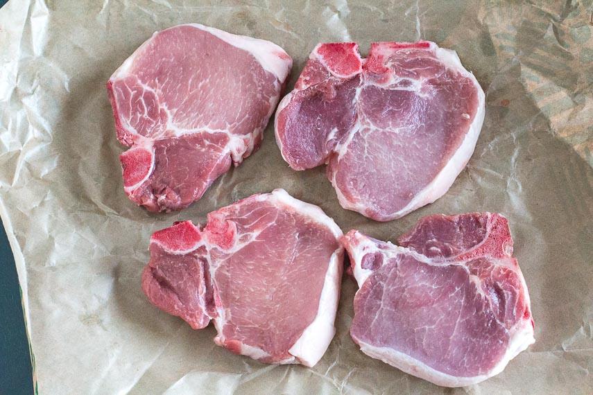 raw pork chops ready to be seasoned for Juicy Pork Chops