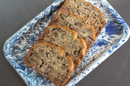 low FODMAP reduced sugar banana bread on blue and white platter