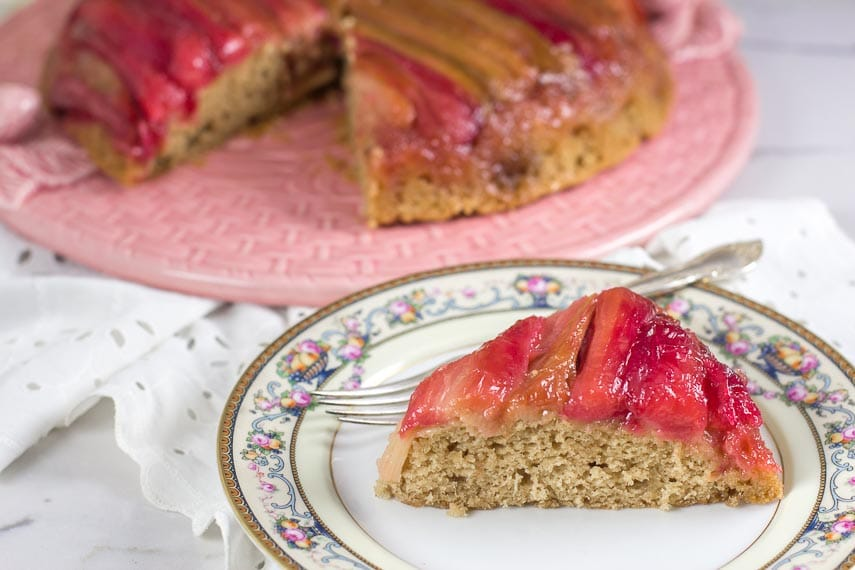 rhubarb upside down cake, slice plated on floral china plate