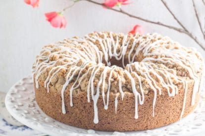 cinnamon streusel coffee cake with white icing drizzled on top