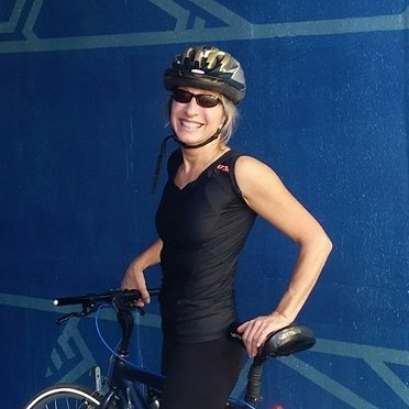 Jennifer Sprung, Neurosomatic Massage Therapist atop her bike about to go out for a spin.