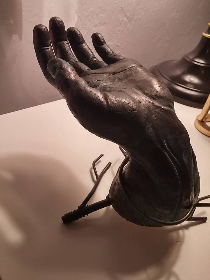 A sculpture of a hand by Jenny Sprung.