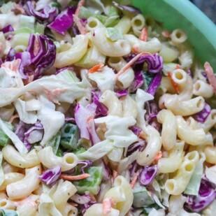 closeup of macaroni slaw in a green bowl
