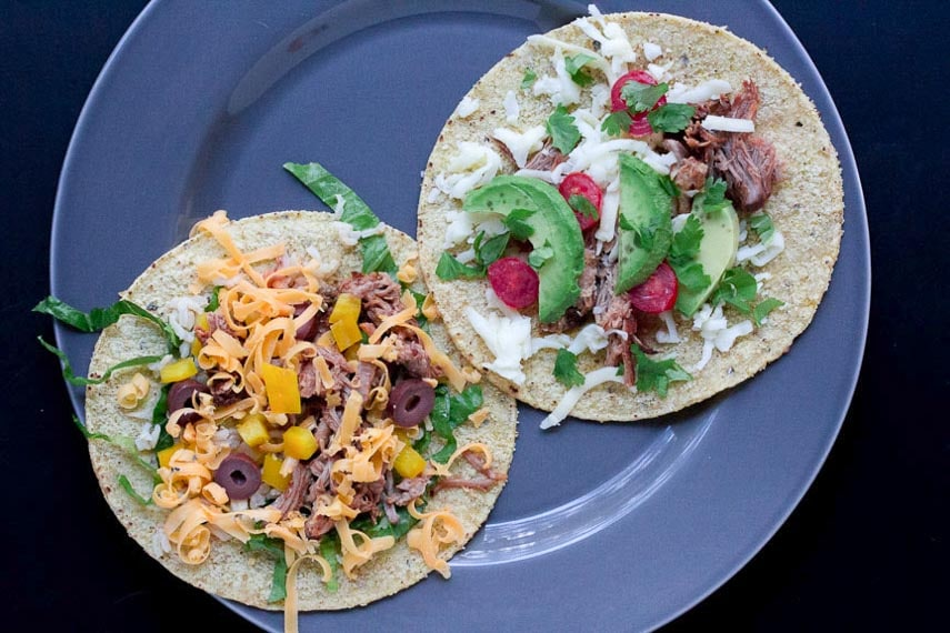 Shredded Dry Rubbed Slow-Roasted Pork on corn tortillas on a gray plate