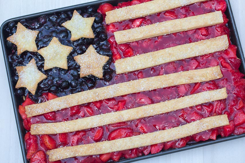Flag Slab Pie in a baking pan against a white and gray quartz background