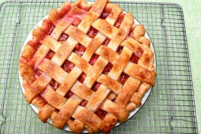 rhubarb-lattice-pie on rack against green background
