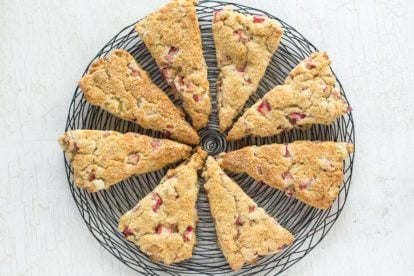 rhubarb scones on a black wire cooling rack