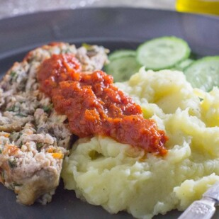 roasted red pepper tomato ketchup on top of mashed potatoes
