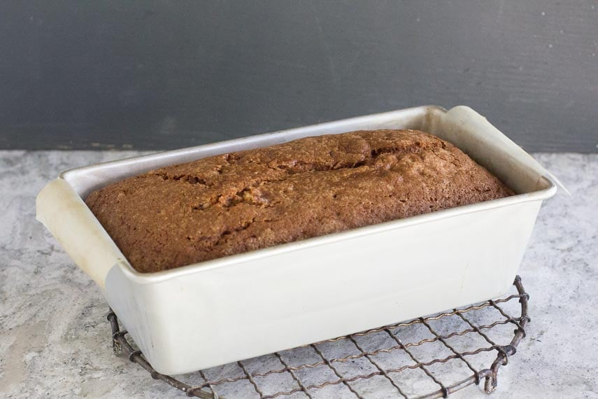 FODMAP IT Nana's banana bread in loaf pan cooling on a rack