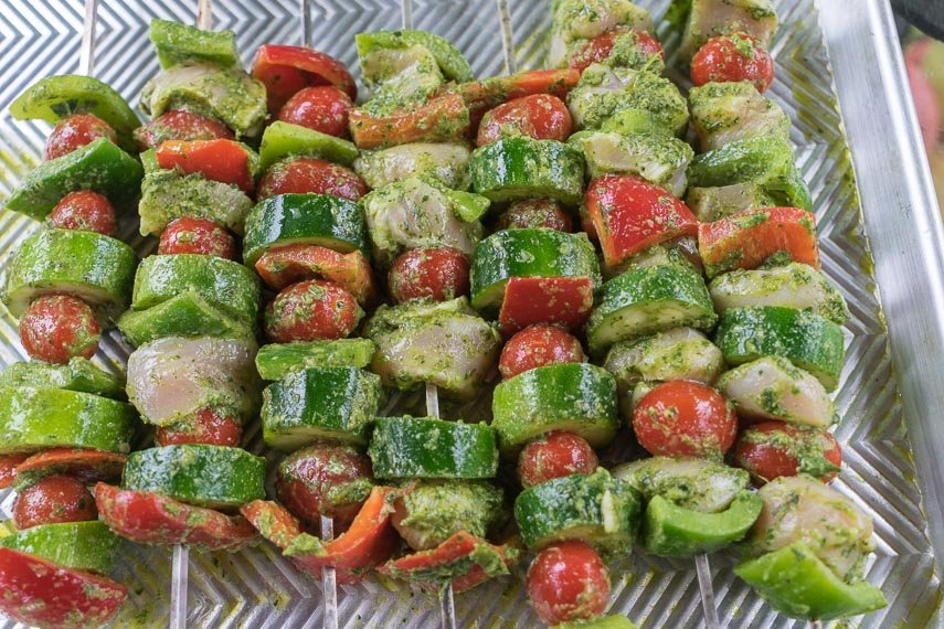 Grilled chicken and vegetable kebobs, raw, marinating on a sheet pan