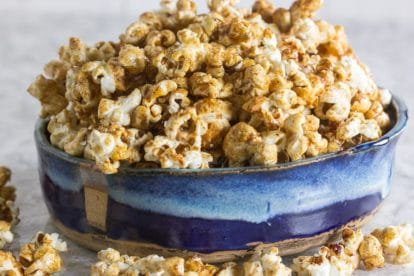 Sweet n spicy kettle corn in a shallow blue ceramic bowl