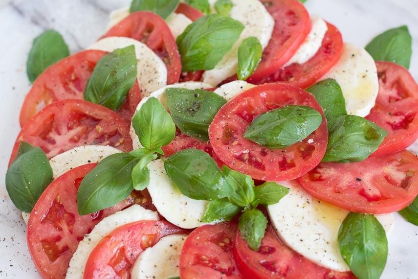 closeup of Caprese salad with lots of pepper
