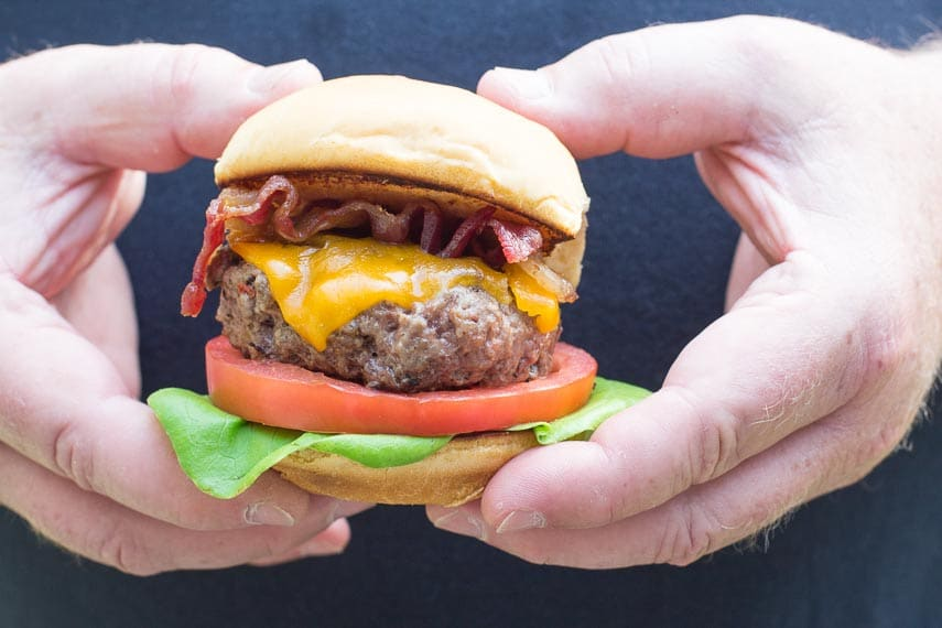 Our Best Low FODMAP burger in two male hands