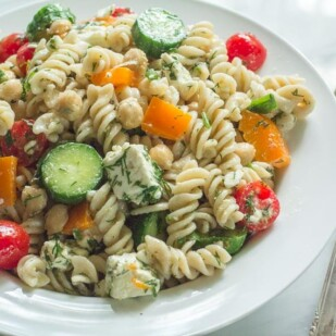 Fusilli Pasta Salad with Chickpeas & Feta in a white bowl