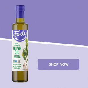 Fody Olive Oil bottle against purple background