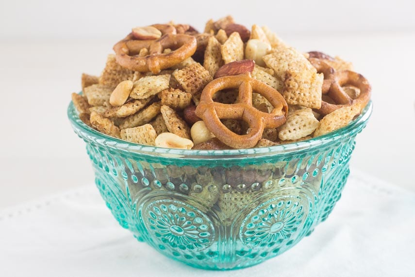 low FODMAP Chex Mix snack in teal glass bowl