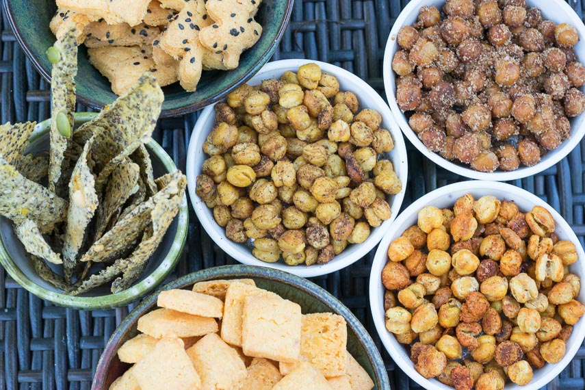 overhead of roasted chickpeas alongside other low FODMAP snacks