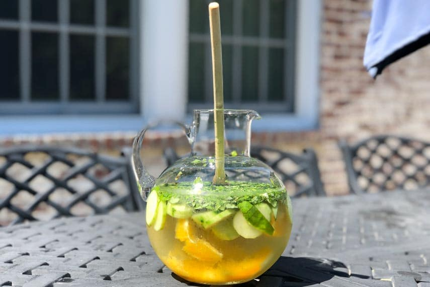 low FODMAP white wine sangria in pitcher on outdoor table