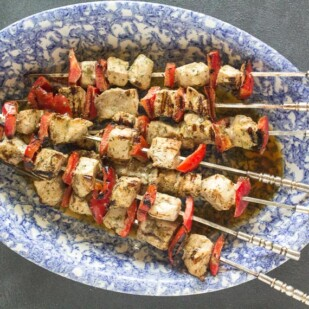 swordfish kebobs on a blue and white oval platter