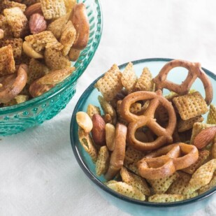 two teal glass bowls of low FODMAP Chex Mix snack