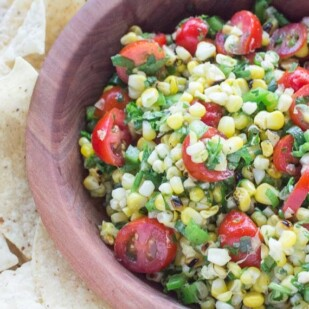 grilled corn salsa in wooden bowl with side of corn chips