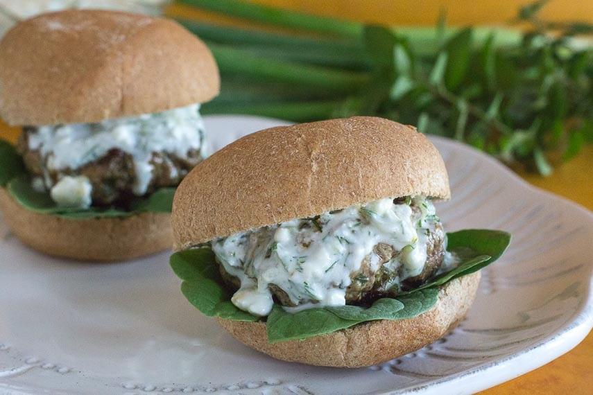 lamb burgers in bun on white plate