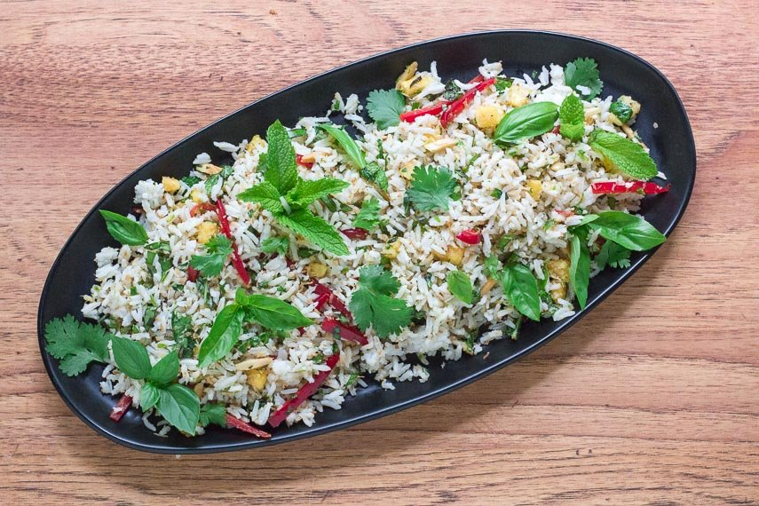 low FODMAP coconut rice salad on a black oval plate