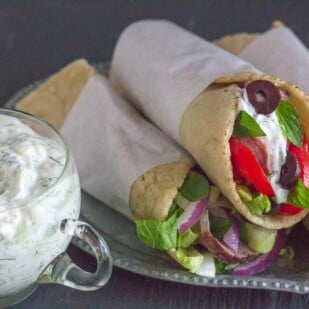 low FODMAP lamb gyros with feta tzatziki piled on a plate