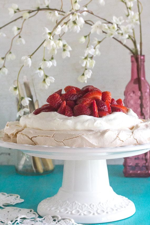 low FODMAP strawberry pavlova on white plate