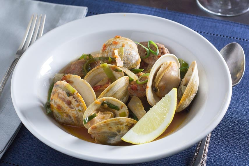 roast clams & spicy sausages in white bowl