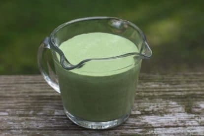 Low FODMAP Green Goddess dressing in a measuring cup