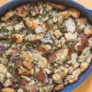 Low FODMAP Sourdough Apple Stuffing with Sausage in blue casserole dish