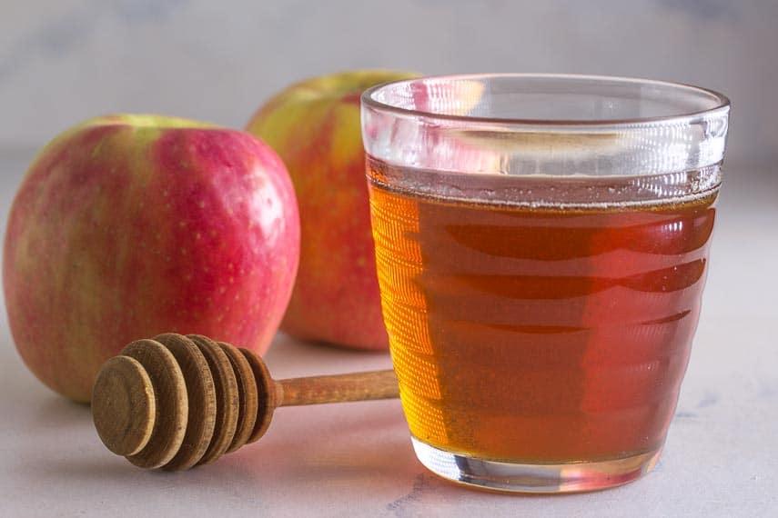 apples & honey against a white backdrop