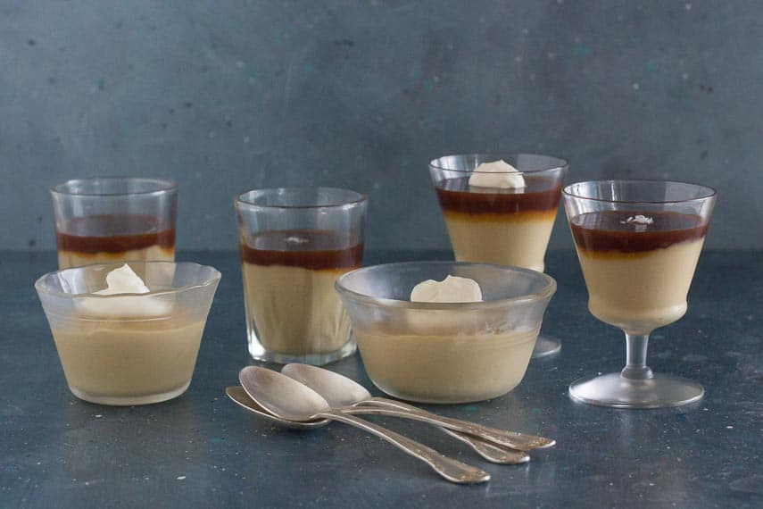 array of butterscotch puddings with salted caramel or whipped cream topping