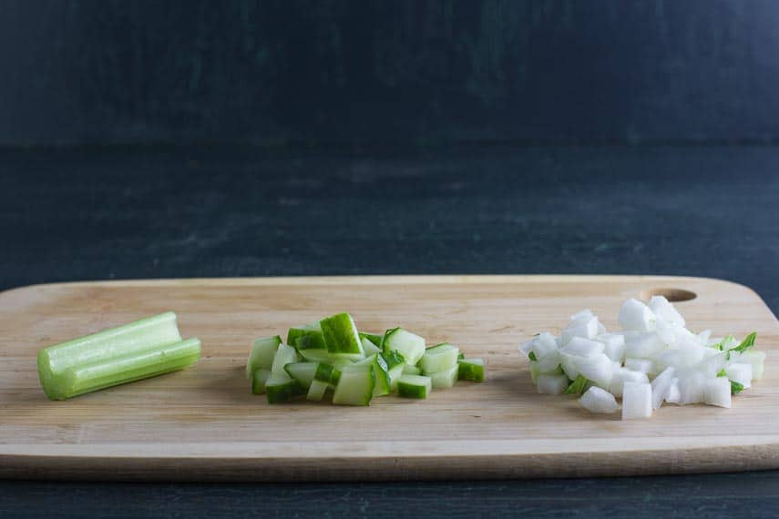 celery, cucumber and bok choy on wooden board