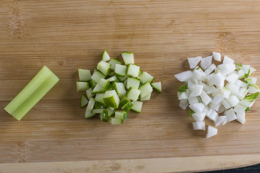 celery, cucumbers and bok choy, chopped on a wooden board