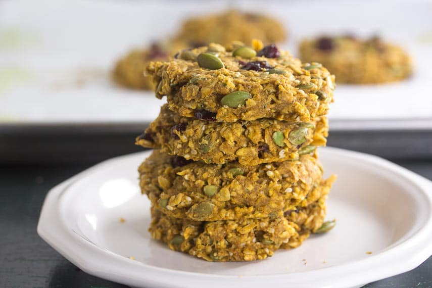 stack of Low FODMAP Pumpkin Cranberry Oat Breakfast Cookies on a white plate