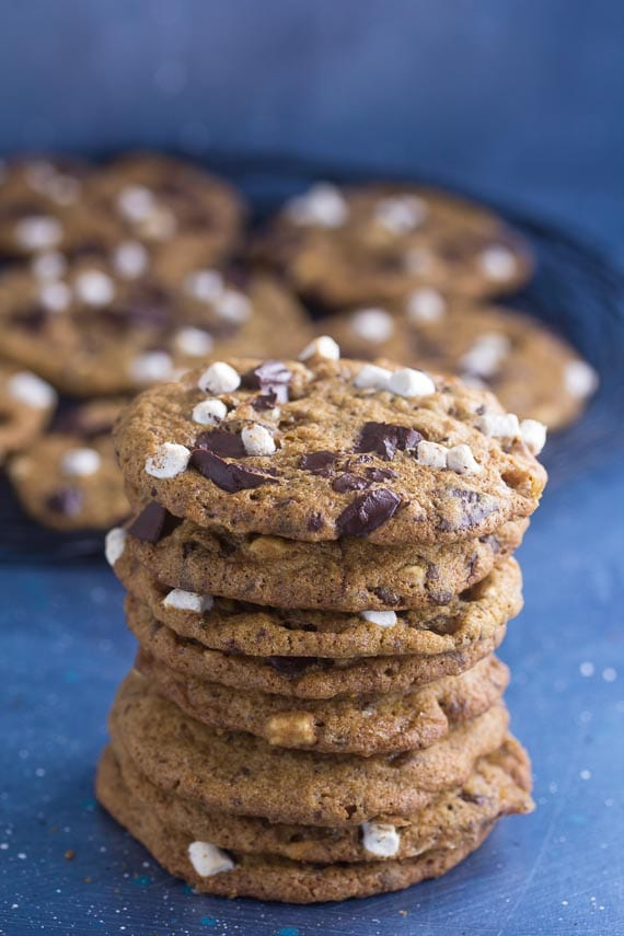 stack of low FODMAP S'more chocolate chunk cookies on blue background