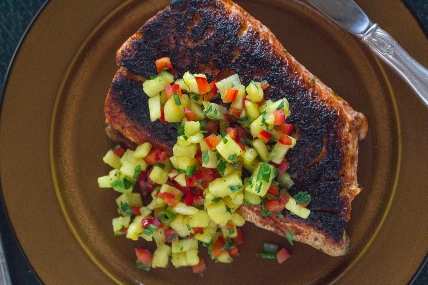 Blackened Salmon with low FODMAP sweet & spicy dry rub and pineapple salsa on a brown plate
