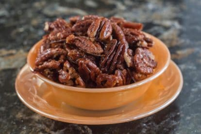 Bowl of low FODMAP Candied Spiced Pecans