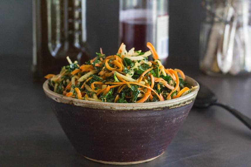 Low FODMAP Kale, Carrot & Apple Salad in a ceramic bowl