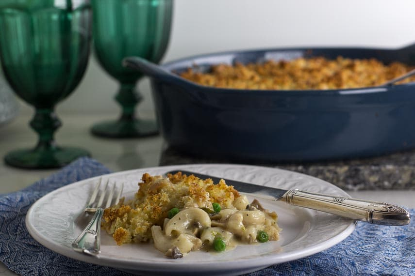 Low FODMAP Tuna Noodle Casserole on white plate and in blue casserole dish