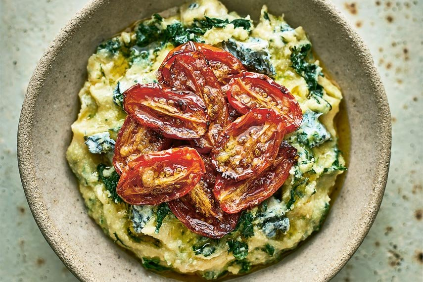 Spinach and Blue Cheese Polenta with Slow-Roasted Tomatoes in a rustic bowl