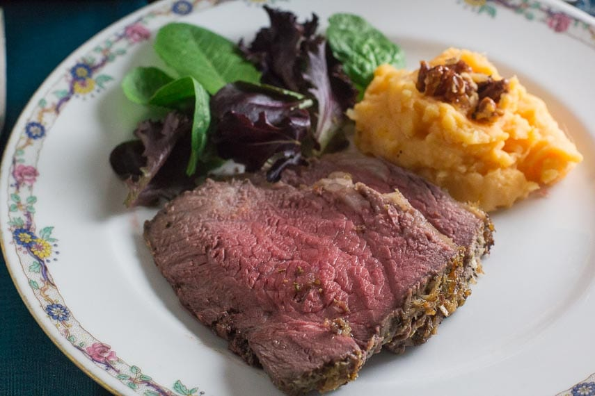 closeup of low FODMAP horseradish crusted roast beef on decorative plate