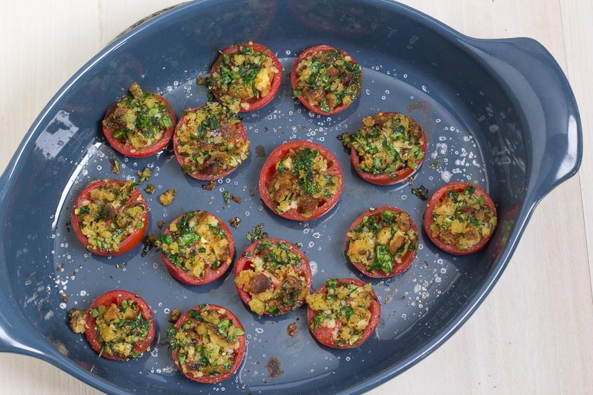 cooked tomatoes Provencal in blue ceramic dish